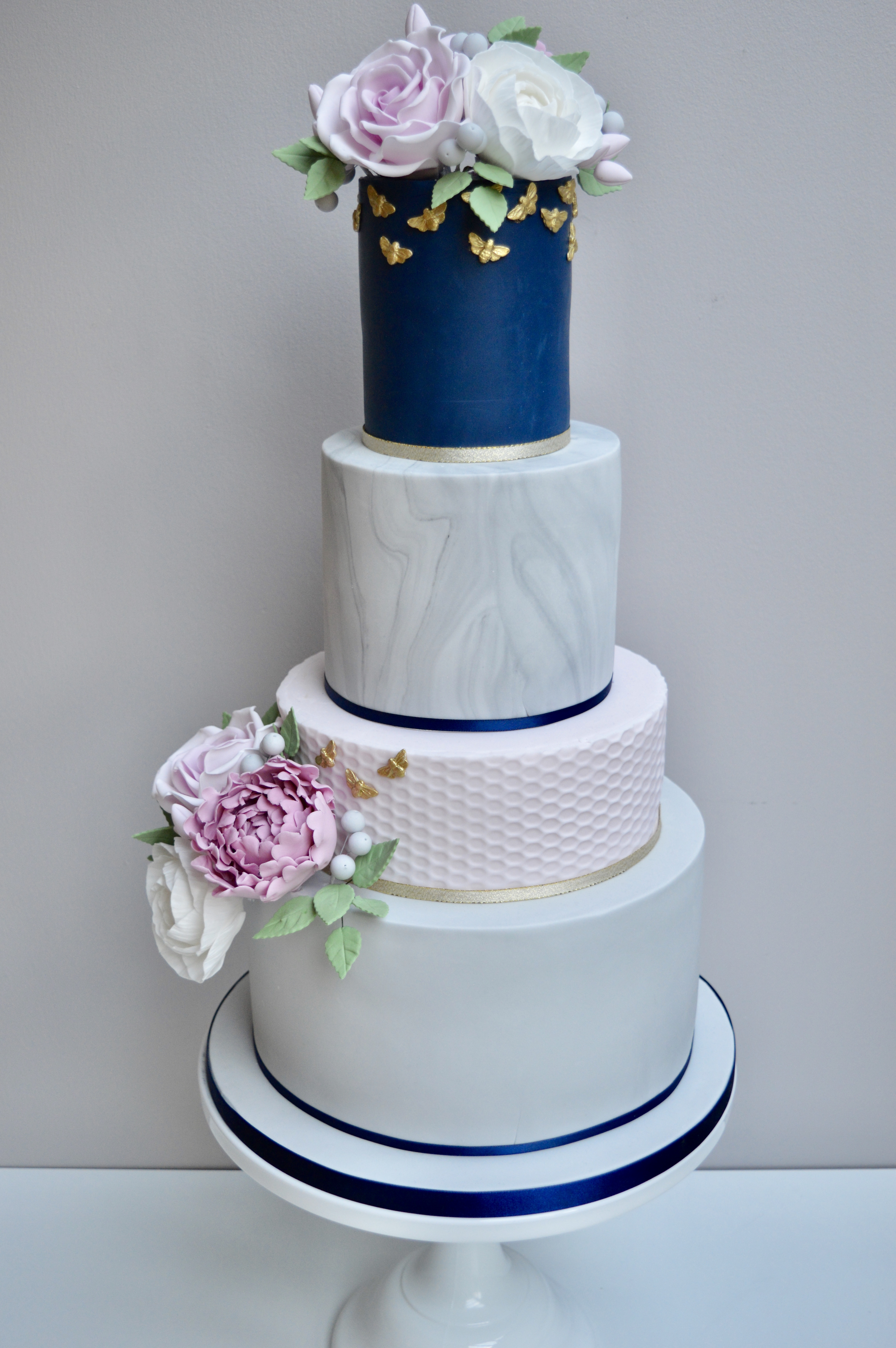 Wonderful 4 tier wedding cake with roses and peonies